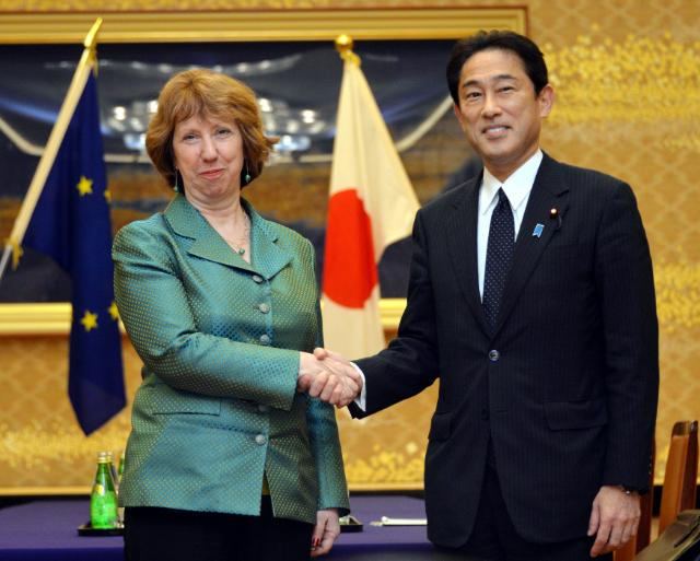 HR Ashton shaking hands with Japan's Minister of Foreign Affairs, Fumio Kishida